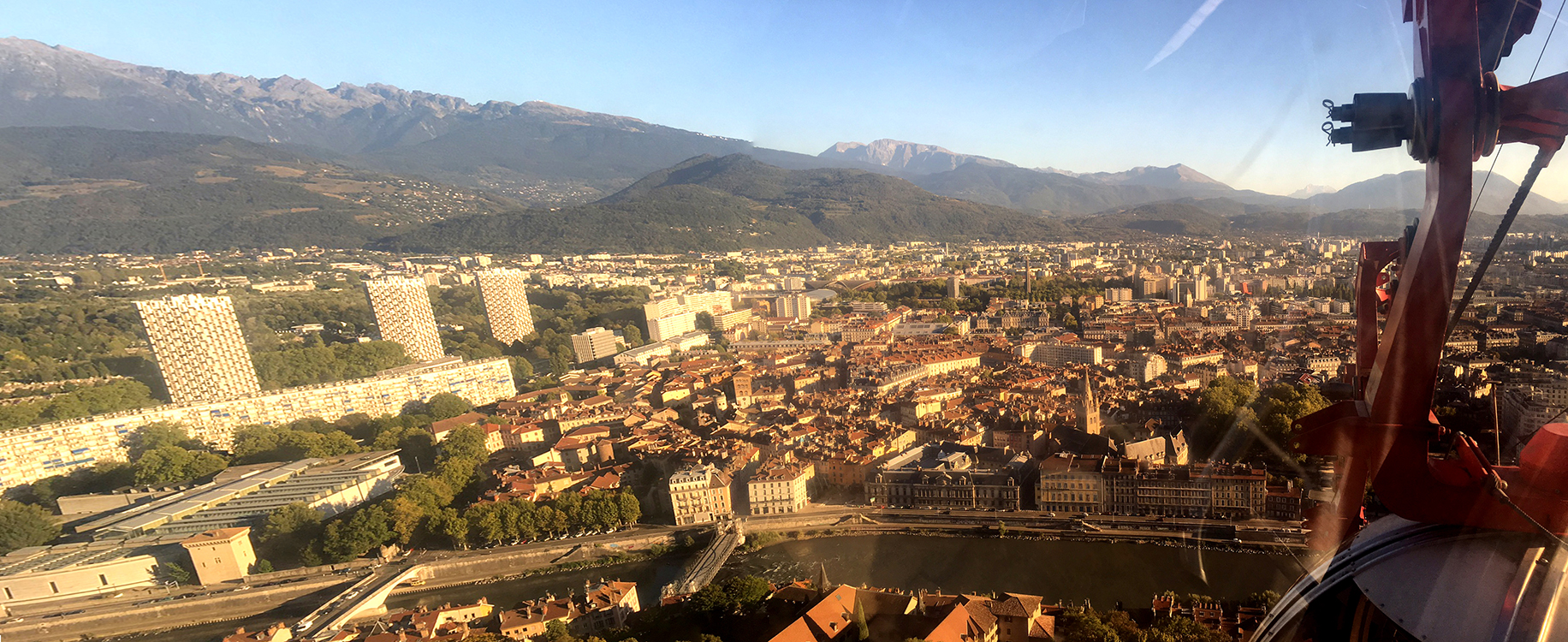 Wide angle shot of the city of Grenoble from a cable car.