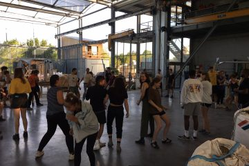 Many people engaging in an activity with each other in a big space.