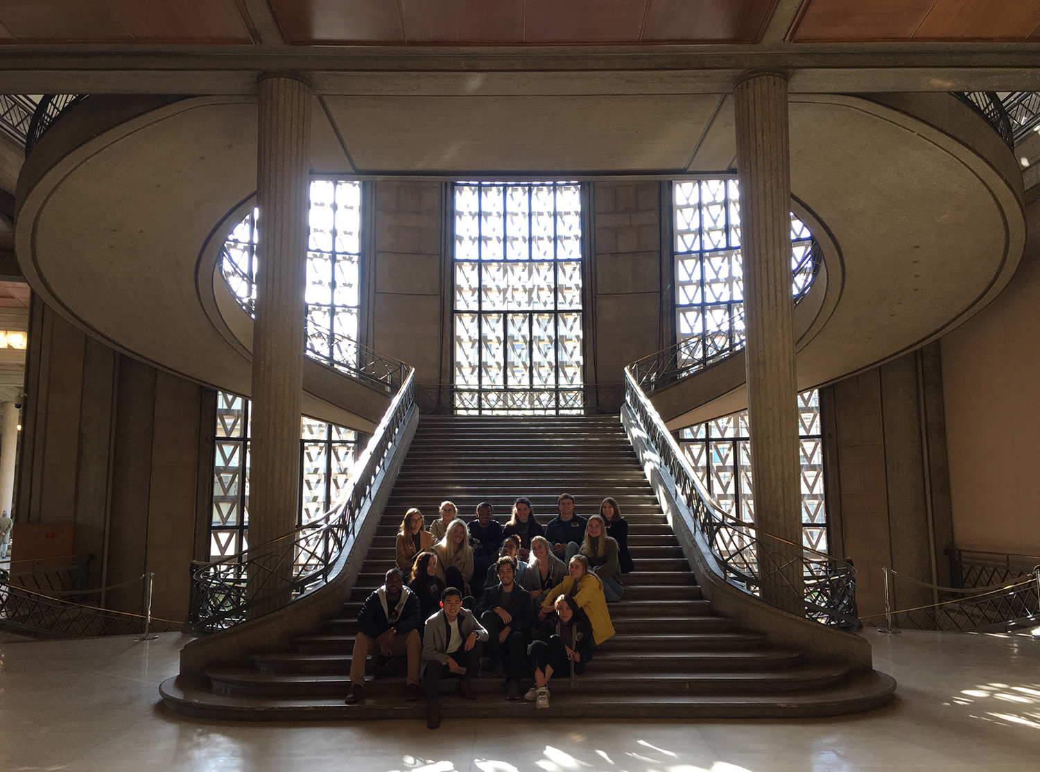 A group of people sitting on a staircase.